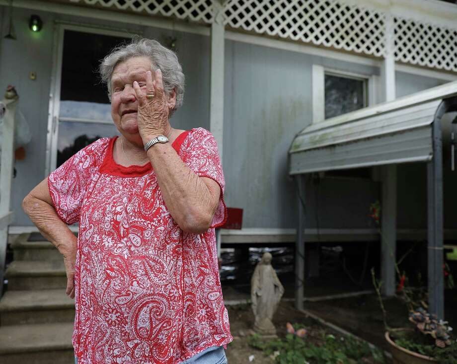 """Linda Satsky wipes tears away from her eyes as she talks about getting rejected from FEMA for assistance. """"I live on Social Security, I don't have extra money,"""" said Satsky. Residents in Liberty, Texas talk about dealing the with aftermath of Hurriane Harvey onTuesday, Sept. 19, 2017. The National Weather Service estimates that Liberty County received more than 54 inches of rain when Harvey lashed the region late last month( Elizabeth Conley / Houston Chronicle ) Photo: Elizabeth Conley, Staff / © 2017 Houston Chronicle"""