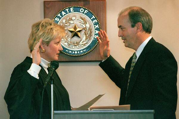 Susan Reed went from judge to district attorney, but lost re-election in 2014 to Nico LaHood. Now, she has been appointed to preside over a capital case that will be prosecuted by LaHood's office. Here, then-Judge Reed adminsters the oath of office to Judge Patrick Boone.