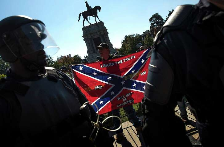 "A dangerous tribalism has descended on the country — blues who are secular and diverse and reds who are religious and largely white, both intent on squelching the other. Here, Richmond police keep members of the Tennessee based group ""New Confederate State of America"" separated from counter protesters Sept. 16."