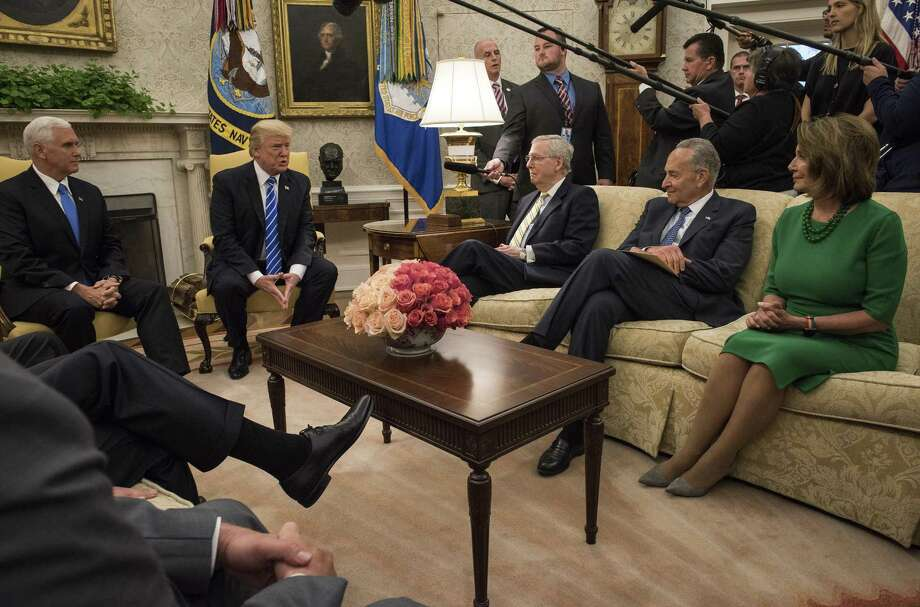 The border wall wouldn't survive this meeting. President Donald Trump meets with congressional leadership in the Oval Office on September 16, 2017 in Washington. Among them were Senate Minority Leader Charles Schumer and House Minority Leader Nancy Pelosi, who have apparently struck a DACA deal that sacrifices Trump's wall. Photo: Bill O'Leary /The Washington Post / The Washington Post