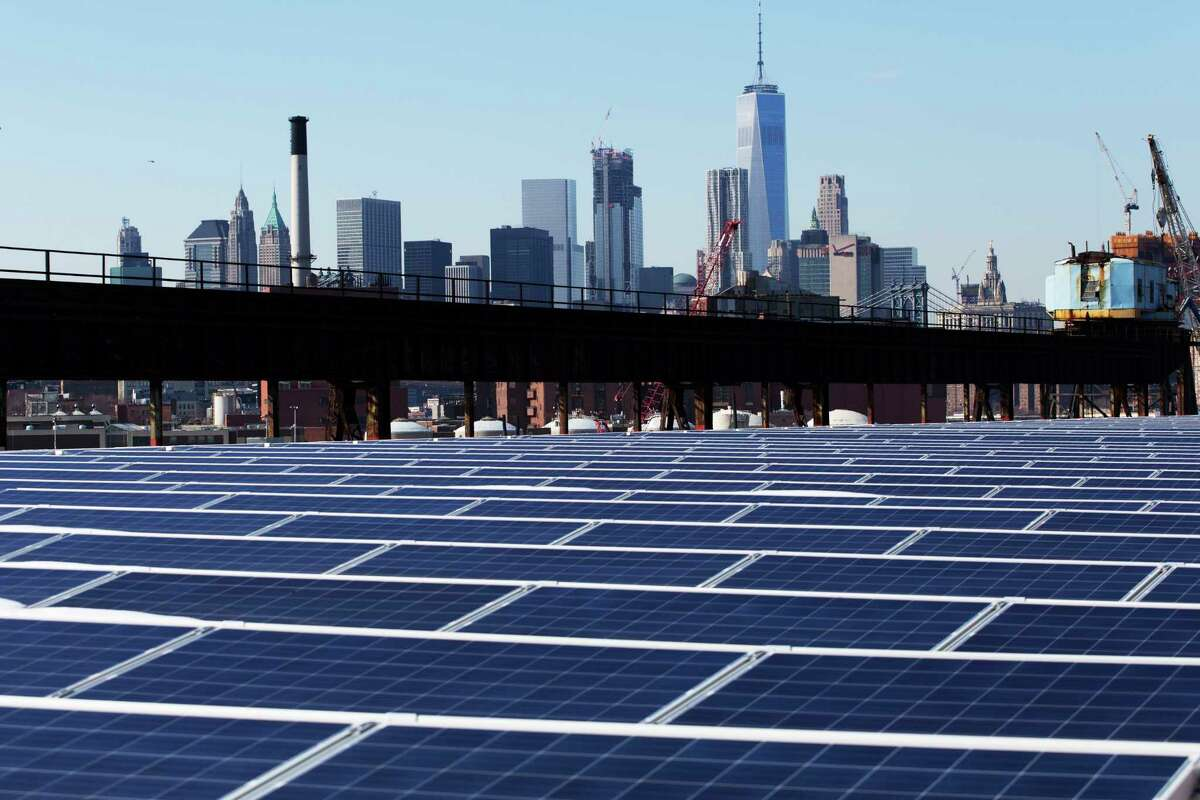 Solar panels cover a rooftop at the Brooklyn Navy Yard in New York. The solar industry has been growing rapidly in the U.S.