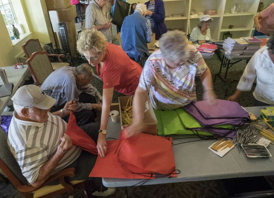 Volunteers at Brookdale Senior Living pack backpacks with school supplies Thursday to be sent to Houston area school children affected by Hurricane Harvey. Students have undergone life-altering events because of the Hurricane. The state should keep that in mind. Photo: Tim Fischer /Midland Reporter-Telegram