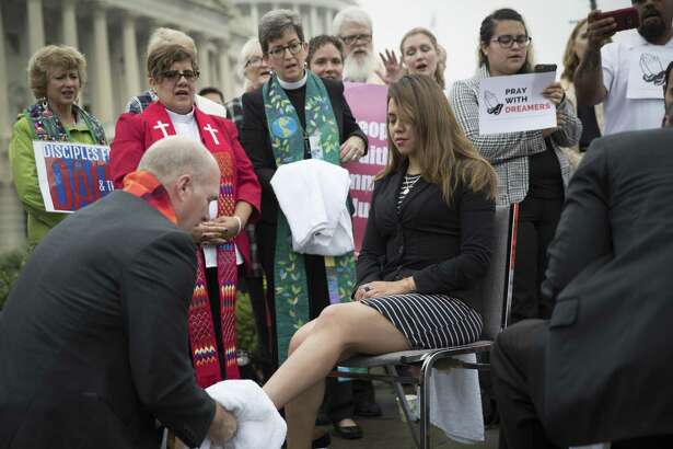 Deyanira Aldana, who was accepted into the Deferred Action for Childhood Arrivals program, has her feet washed by a member of the clergy on Sept. 13 during a demonstration about immigration legislation on Capitol Hill in Washington. The parents of the Dreamers are criminals and DACA recipients have reaped the benefits of their parents' crimes, says a reader.