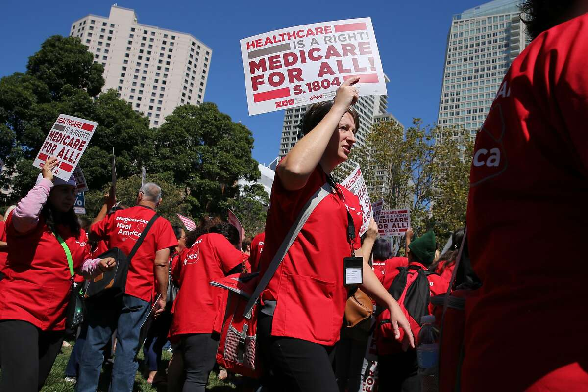 Sarah Johnson rallies with a California nurses convention at Yerba Buena Gardens on Friday, Sept. 22, 2017, in San Francisco, Calif. Sen. Bernie Sanders, I-Vt., spoke at the nurses rally to promote his Medicare for All 2017 plan.