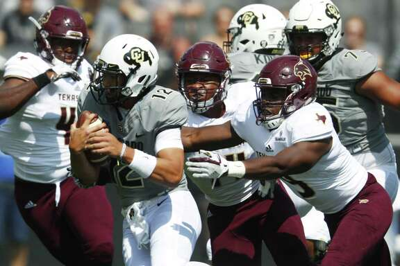 Colorado quarterback Steven Montez (12) is sacked by, from back left, Texas State safety Quinn Tiggs, and linebackers Easy Anyama and Bryan London II in the first half on Sept. 9, 2017, in Boulder, Colo.
