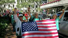 "Demonstrators march outside federal court in New Orleans, Friday, Sept. 22, 2017. With immigrants and their advocates chanting and beating drums outside, a federal appeals court heard arguments Friday on whether it should allow a Texas law aimed at combatting ""sanctuary cities"" to immediately take effect. (AP Photo/Stacey Plaisance Jenkins)"