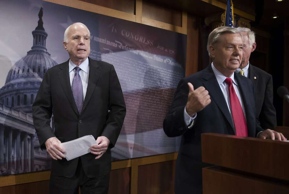Sen. John McCain, R-Ariz., left, said Friday he won't vote for the Republican bill repealing the Obama health care law. Photo: Cliff Owen, Associated Press