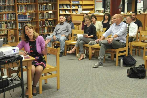 Assistant Susan Lubomski presented recent reading assessment scores for district students to the Torringon Board of Education Tuesday.