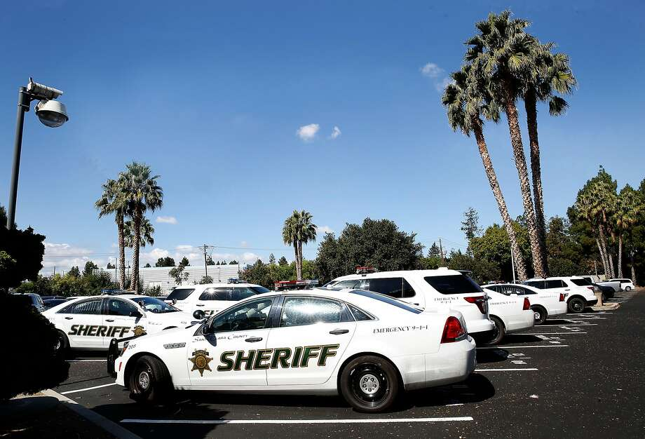 No weapons have been stolen since Santa Clara County's sheriff bought gun vaults for deputies' staff and personal cars in 2016. Officers who travel with guns can't take them in places where they are prohibited. Photo: Liz Hafalia, The Chronicle
