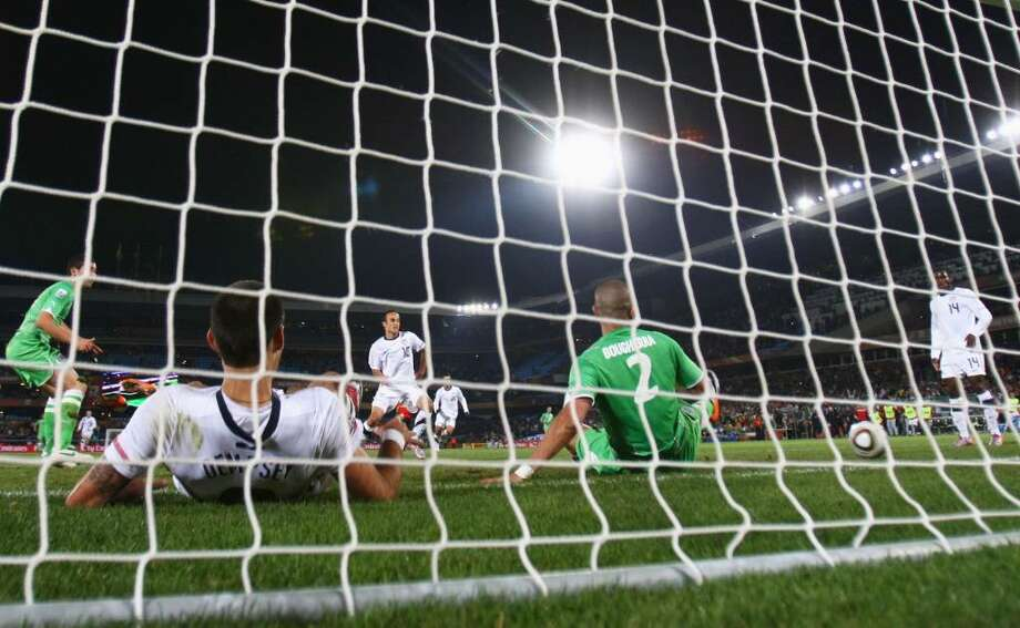 PRETORIA, SOUTH AFRICA - JUNE 23:  Landon Donovan of the United States scoring the winning goal that sends the USA through to the second round during the 2010 FIFA World Cup South Africa Group C match between USA and Algeria at the Loftus Versfeld Stadium on June 23, 2010 in Tshwane/Pretoria, South Africa.  (Photo by Martin Rose/Getty Images) *** Local Caption *** Landon Donovan Photo: Martin Rose, Getty Images / 2010 Getty Images