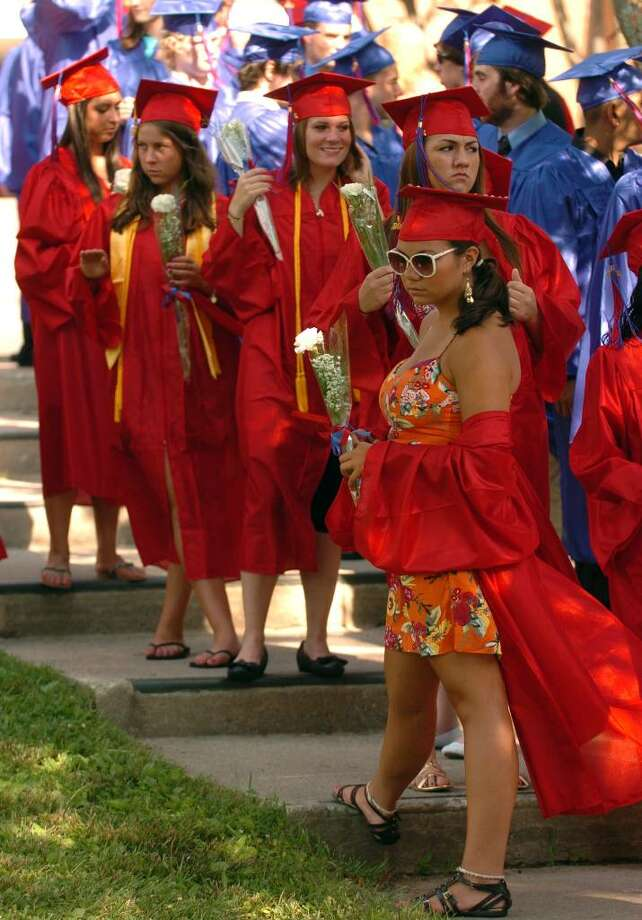 Because of the high temperatures, graduate Carly Cammarano keeps her graduation gown off to keep cool, before the start of Foran High School's Graduation Exercises in Milford, Conn. on Wednesday June 23, 2010. Photo: Christian Abraham / Connecticut Post