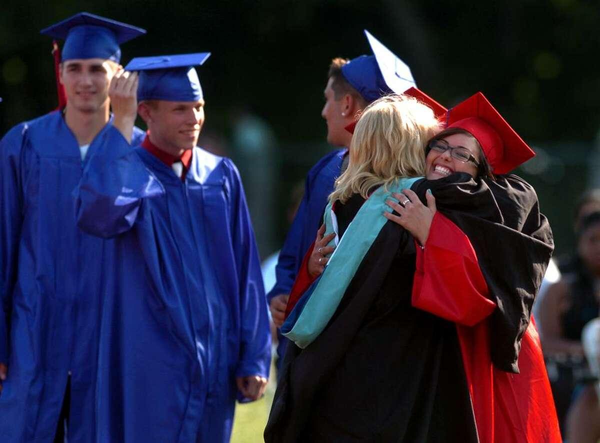 Graduate Patricia Ann Boyle, right, hugs teacher Lori Hart, during Foran High School's Graduation Exercises in Milford, Conn. on Wednesday June 23, 2010.