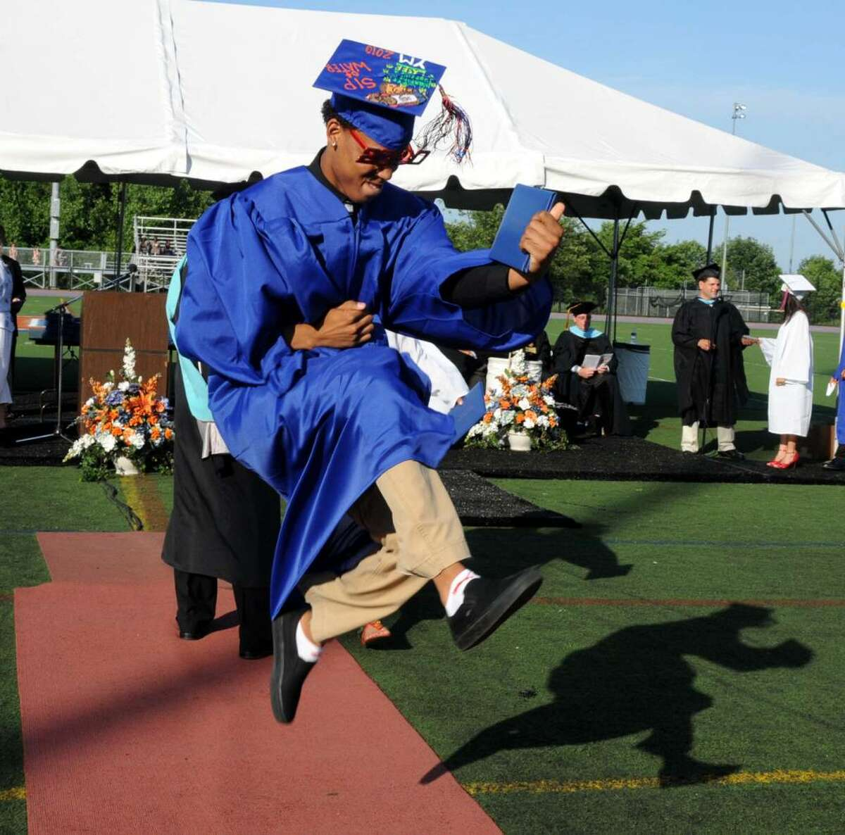 Eric Paredes, 19, jumps for joy after he receives his diploma at the Danbury High School commencement exercises on Wednesday June 23, 2010, at Danbury High School.