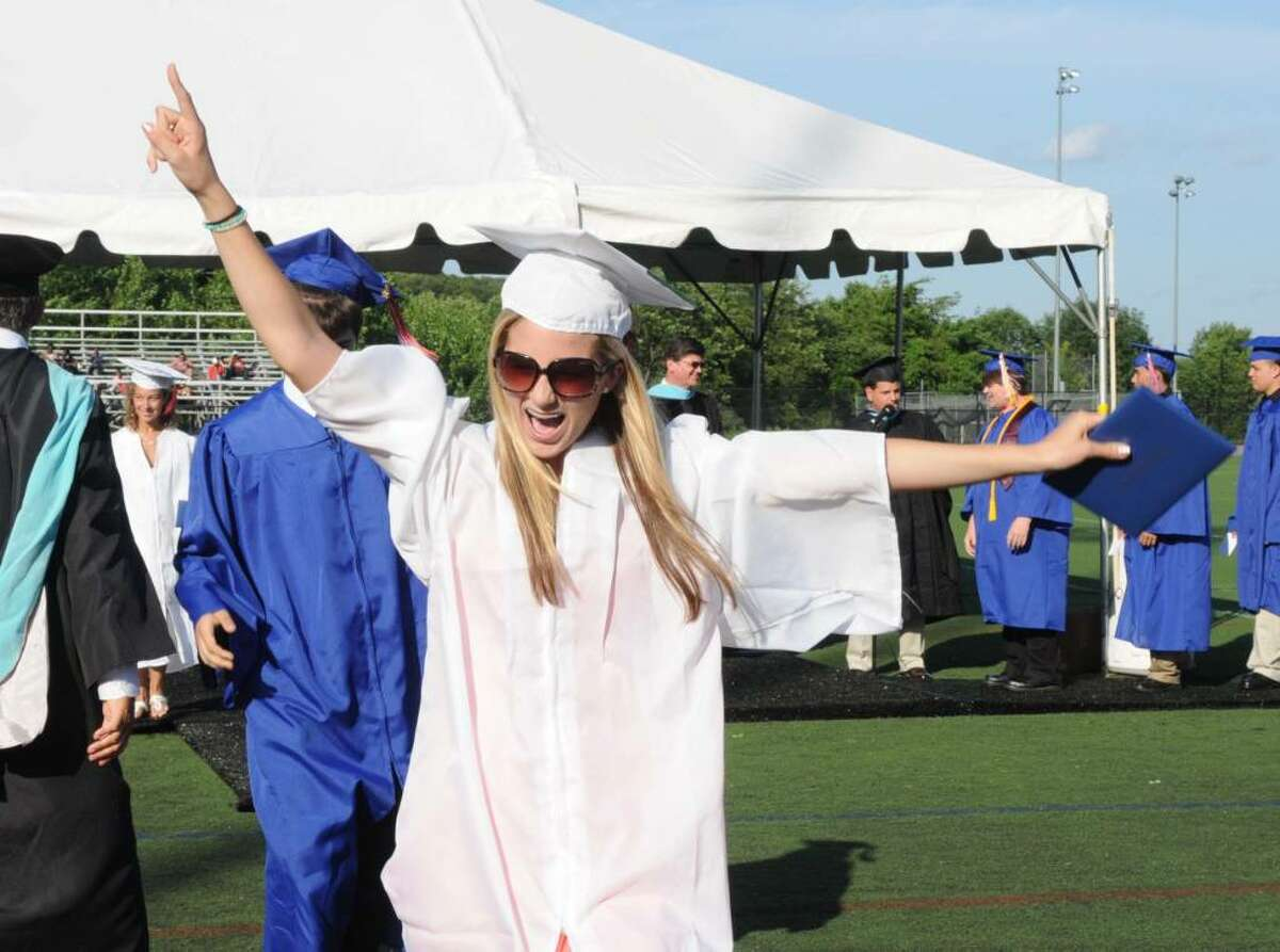 Brittany Mikelic, 17, gives a shout after she receives her diploma during the Danbury High School commencement exercises on Wednesday June 23, 2010 at Danbury High School.