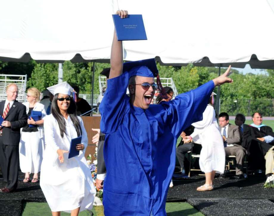 Douglas Delima, 18, receives his diploma with great excitment during the Danbury High School commencement exercises on Wednesday June 23, 2010 at Danbury High School. Photo: Lisa Weir / The News-Times Freelance