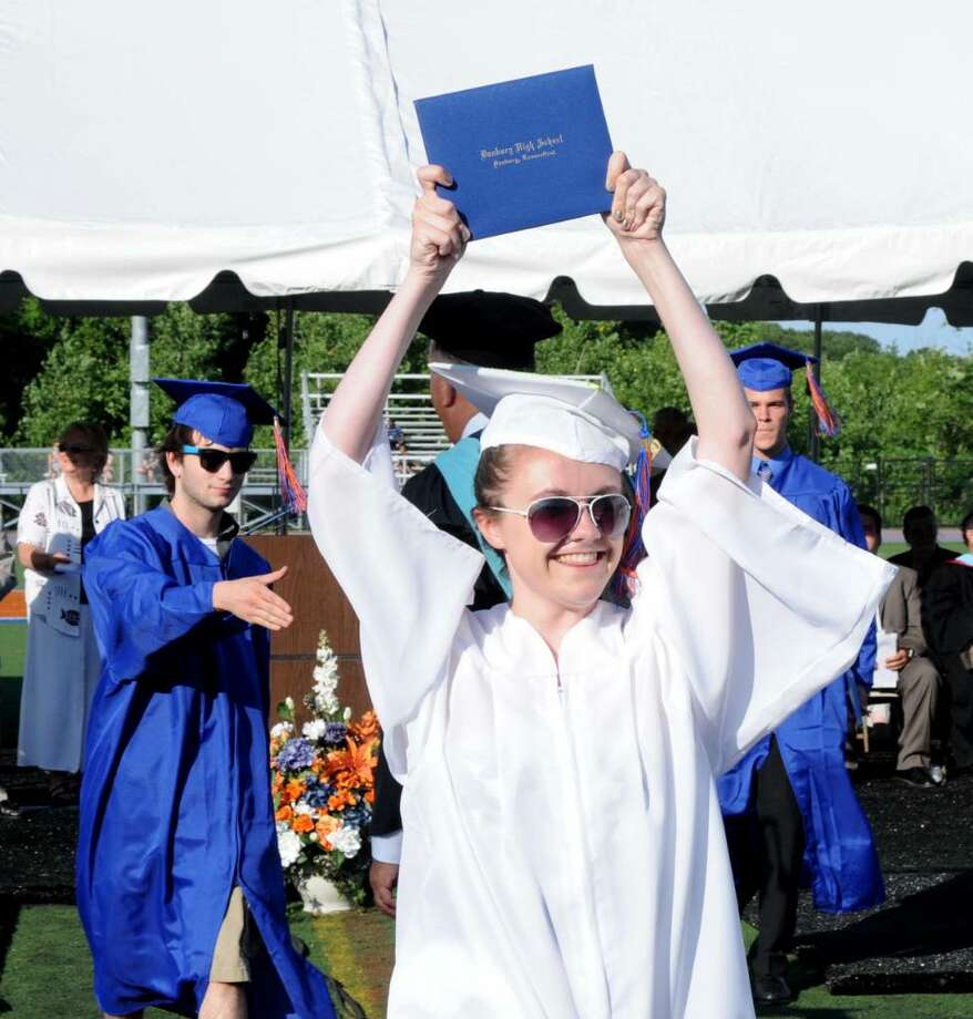 Kaitlin Cooke, 18, proudly displays her diploma after receiving it during the Danbury High School commencement exercises on Wednesday June 23, 2010 at Danbury High School. Photo: Lisa Weir / The News-Times Freelance