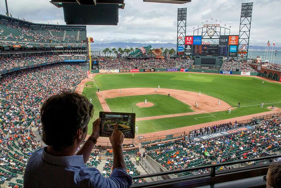 Chad Evans, an executive with MLB Advanced Media, offers a preview of the At Bat app at AT&T Park. The app is designed to give fans a better under standing of players and strategies. Photo: Santiago Mejia, The Chronicle