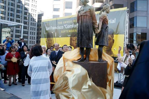 Dignitaries unveil the Comfort Women Memorial statue to honor comfort women from World War II at St. Mary's Square park in Chinatown in San Francisco, Calif. on Friday, Sept. 22, 2017. During the war, thousands of women were captured and used as sex slaves by the Japanese military.