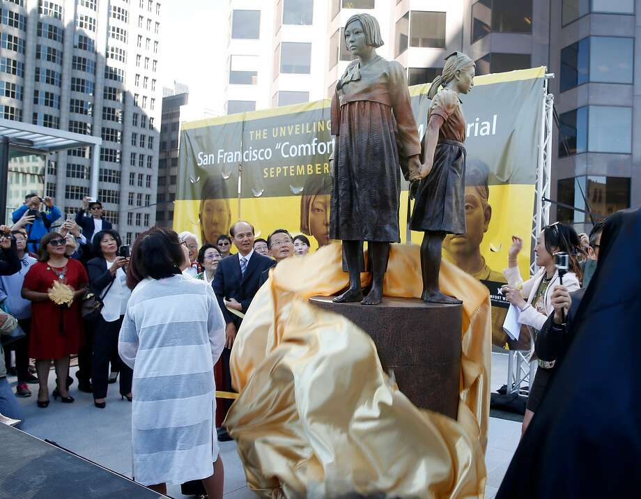 Dignitaries unveil the Comfort Women Memorial statue to honor comfort women from World War II at St. Mary's Square park in Chinatown in San Francisco on Sept. 22, 2017. During the war, thousands of women were captured and used as sex slaves by the Japanese military. Photo: Paul Chinn, The Chronicle