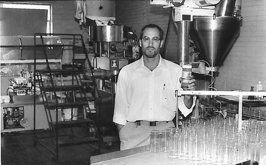 Carlo Busceme III, then-vice president and secretary-treasurer, holds a finished bottle of TexJoy seasoning days before becoming president of the Texas Coffee Company, 1997. Photo: Enterprise File Photo