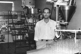 Carlo Busceme III, then-vice president and secretary-treasurer, holds a finished bottle of TexJoy seasoning days before becoming president of the Texas Coffee Company, 1997.