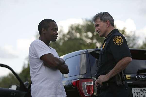 San Antonio Police Department Chief William McManus talks with Joseph Hammond, who requested to speak with McManus, as McManus works on the east side of San Antonio on Thursday, September 21, 2017.