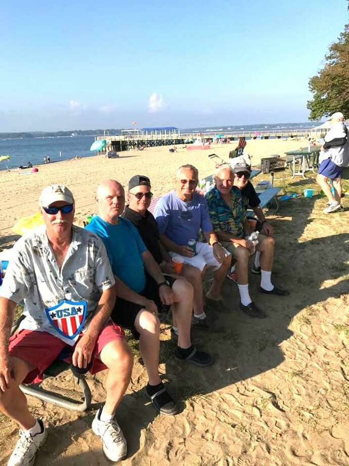 Long-time Greenwich natives and friends celebrate closing day at Island Beach Photo: Contributed
