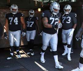 Oakland Raiders' Donald Penn (72), Vadal Alexander (74), Mario Edwards, Jr. (97) and Marshall Newhouse (73) head out to warm up before playing New York Jets during NFL game at Oakland Coliseum in Oakland, Calif., on Sunday, September 17, 2017.
