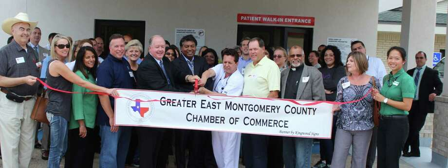 Dr. Ravi Moparty (left) and M. D. Rafael Delaflor-Weiss (right) cut the ribbon welcoming the Cleveland Emergency Hospital ER-Porter into the Greater East Montgomery County Chamber of Commerce on Sept. 21. Photo: Jacob McAdams
