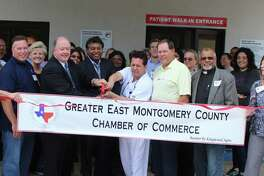 Dr. Ravi Moparty (left) and M. D. Rafael Delaflor-Weiss (right) cut the ribbon welcoming the Cleveland Emergency Hospital ER-Porter into the Greater East Montgomery County Chamber of Commerce on Sept. 21.