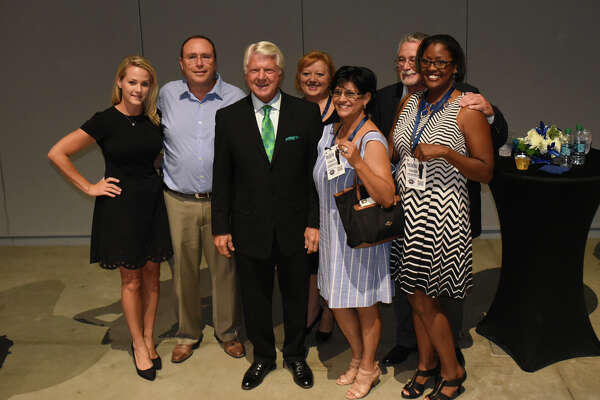 Jimmy Johnson, football broadcaster and former player, coach, and executive, talks to Midlanders during a Meet and Greet before the start of the Habitat For Humanity fundraiser dinner Sept. 22, 2017, at Horseshoe Pavillion.  James Durbin/Reporter-Telegram