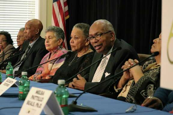 Surviving members of the Little Rock Nine, the students who integrated Central High School in 1957, recount when Army troops escorted them to the campus during an event Friday that commemorates the desegregation anniversary.