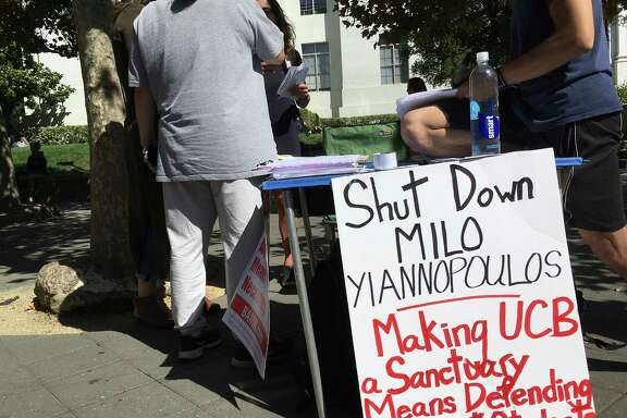 "In this Sept. 21, 2017 photo, a group has put up flyers and a booth on Sproul Plaza calling for protesters to ""Shut Down Milo Yiannopoulos,"" at the University of California, Berkeley campus in Berkeley, Calif. Right-wing showman Milo Yiannopoulos is holding a ""Free Speech Week"" at the University of California, Berkeley with a planned lineup including conservative firebrands Steve Bannon and Ann Coulter. The university says it has no confirmation the headline acts will appear but is preparing strong security to head off any more violent protests at the liberal campus. (AP Photo/Jocelyn Gecker)"