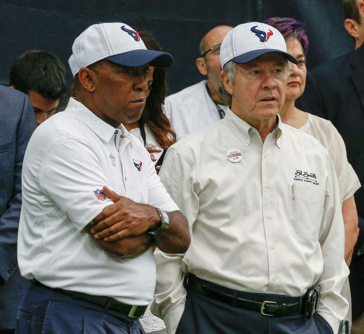Houston Mayor Sylvester Turner, left, and Harris County Judge Ed Emmett watch from the sidelines before the Houston Texans played the Jacksonville Jaguars at NRG Stadium on Sept. 10. (Photo by Bob Levey/Getty Images)