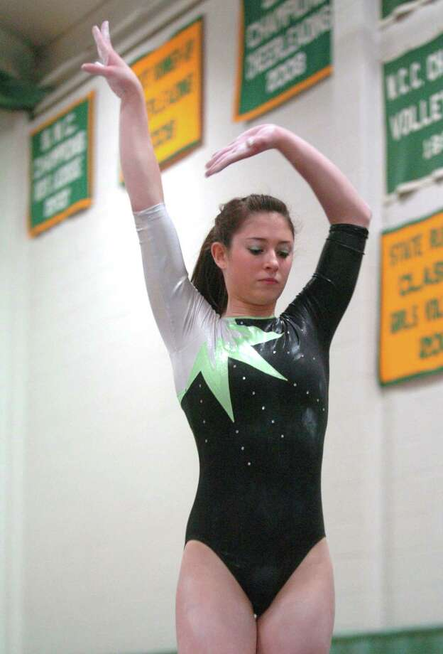 FILE PHOTO: New Milford's Ashley O'Connor competes in the SWC gymnastics championships at New Milford High Thursday, Feb 11, 2010. Photo: Chris Ware / ST / The News-Times