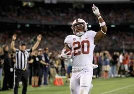 SAN DIEGO, CA - SEPTEMBER 16:   Bryce Love #20 of the Stanford Cardinal reacts to scoring a rushing touchdown during the second half of a game against the San Diego State Aztecs at Qualcomm Stadium on September 16, 2017 in San Diego, California.  (Photo by Sean M. Haffey/Getty Images)