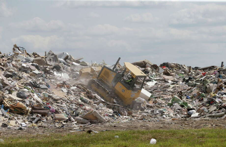 A debris pile is shown in Fort Bend County on Beechnut near the intersection of South Mason Road continued to grow Friday, Sept. 15, 2017, in Richmond. Photo: Melissa Phillip, Houston Chronicle / © 2017 Houston Chronicle