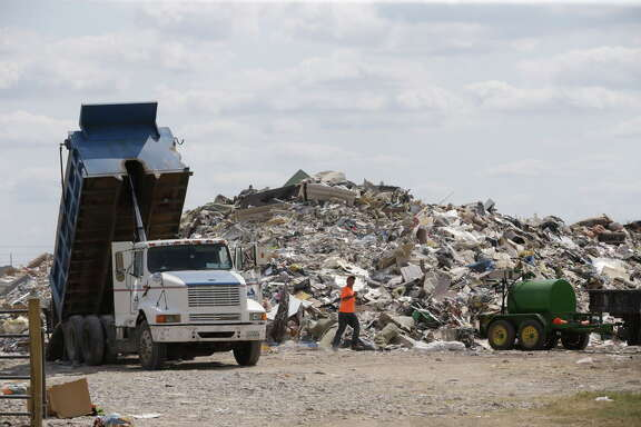 A debris pile is shown in Fort Bend County on Beechnut near the intersection of S. Mason Road Friday, Sept. 15, 2017, in Richmond.