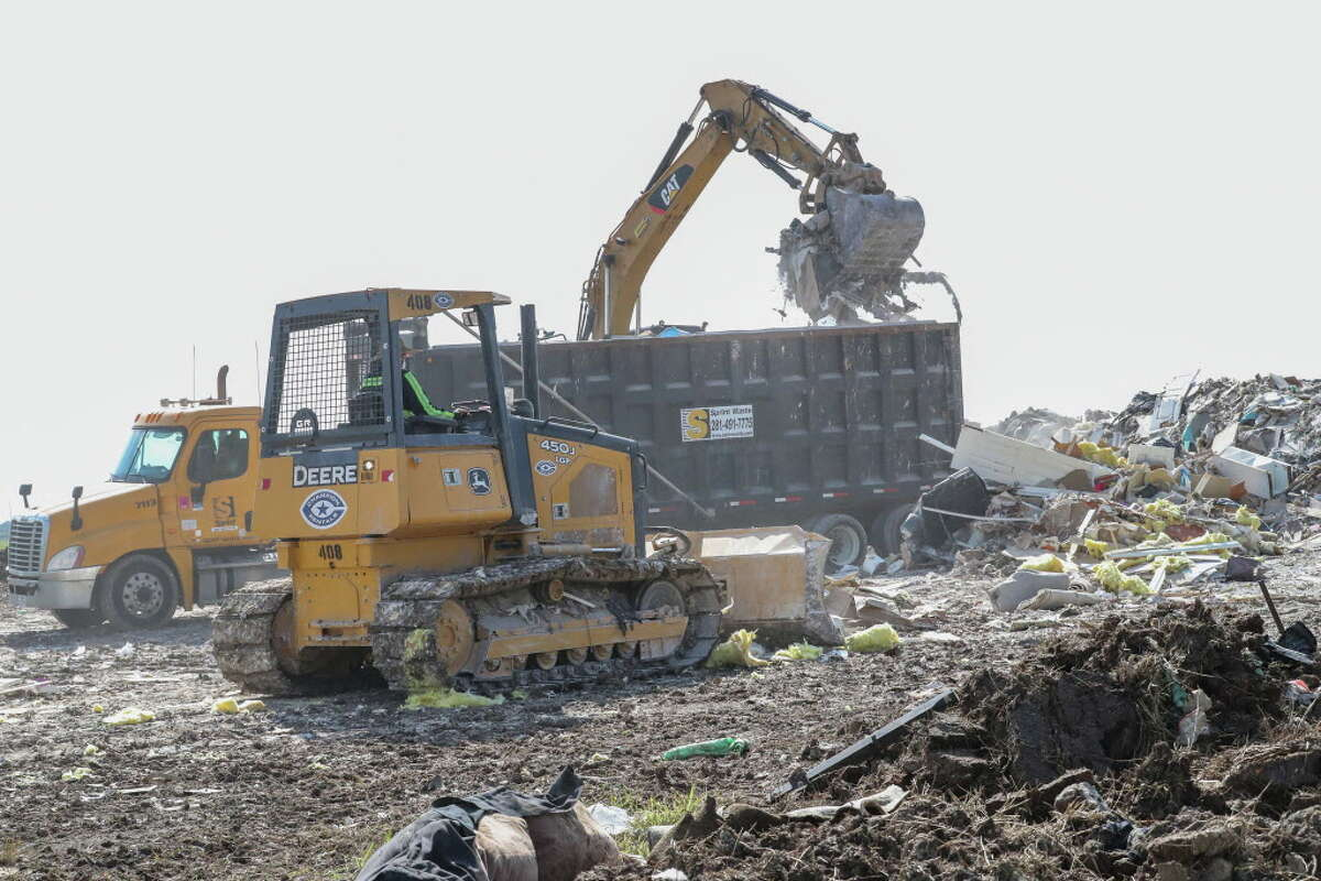 A 100-acre site of vacant land near Beechnut Road is serving as a temporary staging area for debris removed in Richmond from the Grand Mission subdivision by the Mission Municipal Utility District.