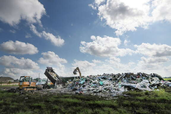 A large debris field near the corner of Beechnut and S. Mason in Richmond.  One of the MUD (municipal utility districts) has set up a dumping area on an open lot Friday, Sept. 22, 2017, in Richmond.