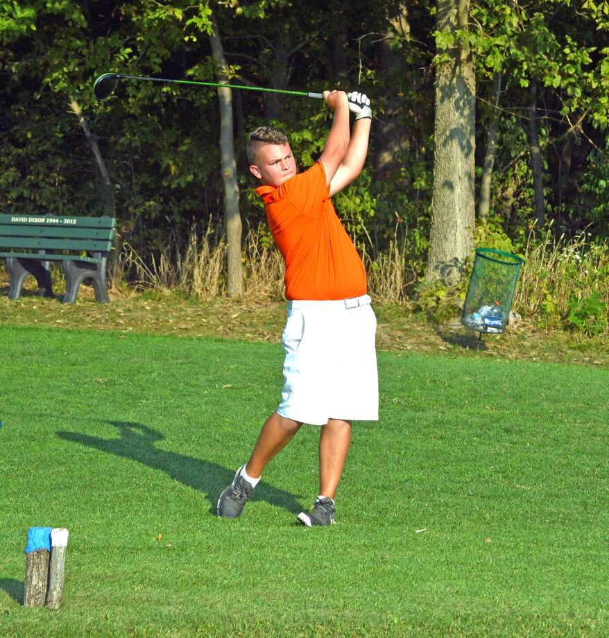 Edwardsville sophomore Ian Bailey, playing for EHS Black, hits a tee shot on hole No. 18 at Oak Brook Golf Club during the Dick Gerber Invitational on Friday.