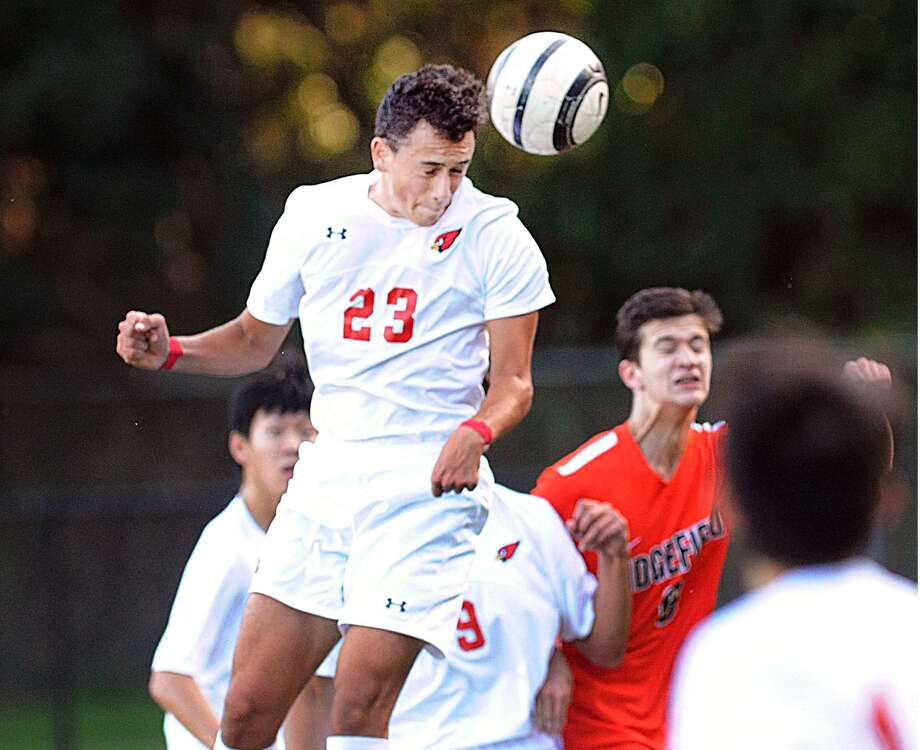 Greenwich's Martin Garcia (23) heads the ball on a cornerkick against Ridgefield Friday afternoon at Greenwich High School. Ridgefield won 1-0 to hand the Cardinals their second loss of the season. Photo: Bob Luckey Jr. / Hearst Connecticut Media / Greenwich Time