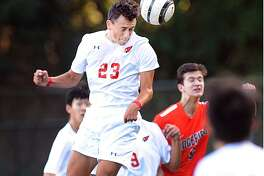 Greenwich's Martin Garcia (23) heads the ball on a cornerkick against Ridgefield Friday afternoon at Greenwich High School. Ridgefield won 1-0 to hand the Cardinals their second loss of the season.