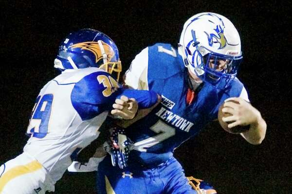 Brookfield High School's Rendino Anthony tries to bring down Newtown High School's Dan Mason in a game played at Newtown. Friday, Sept. 22, 2017