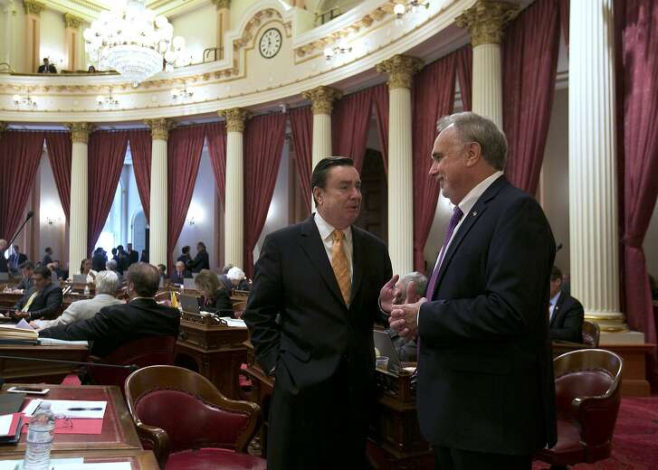 State Sen. Joel Anderson, R-Alpine, left, talks with fellow GOP Sen. Mike Morrell, of Rancho Cucamonga, during the final day of this year's legislative session at the Capitol, Friday, Sept. 15, 2017, in Sacramento, Calif. (AP Photo/Rich Pedroncelli)