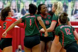 The Woodlands' Amanda Ifeanyi (10) celebrates a block during the first set of a District 12-6A high school volleyball match at Oak Ridge High School, Friday, Sept. 22, 2017.