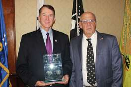 Tri-County Council Vietnam Era Veterans? President Joseph Pollicino, is pictured with the 1st Annual Col. Johnson Award, being held by the first recipient of the Col. Charles R. Johnson Boonie Hat Award; former congressman Michael R. McNulty, for his continuous years of dedicated service to veterans. Col. Johnson was a 1955 West Point Grad and Vietnam commander who donated his time and expertise to the veterans in the Tri-County. He died Jan. 12.  (Gene LoParco)