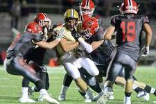 New Canaan defenders sack Trumbull quarterback Colton Nicholas in the first half of an FCIAC varsity football game in New Canaan, Connecticut on Friday, Sept. 22, 2017. New Canaan defeated Trumbull 61-14. See Story B3.