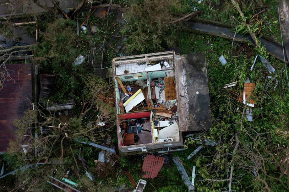 Aerial view of a destroyed house in Juncos, Puerto Rico. Photo: Photo By Dennis M. Rivera Pichardo For The Washington Post. / The Washington Post