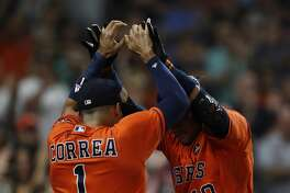 Houston Astros Yuli Gurriel (10) celebrates with Carlos Correa (1)  after hitting a three-run home run during the seventh inning of an MLB baseball game at Minute Maid Park, Friday, Sept. 22, 2017, in Houston.  ( Karen Warren / Houston Chronicle )